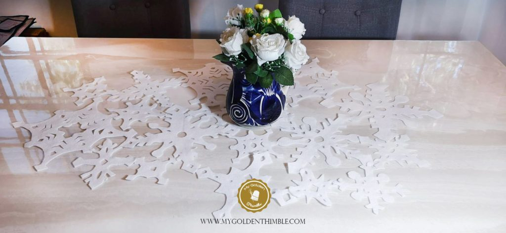 Modern Table Runner for Christmas Decorations. Download our Free Snowflakes pattern on SVG format here.